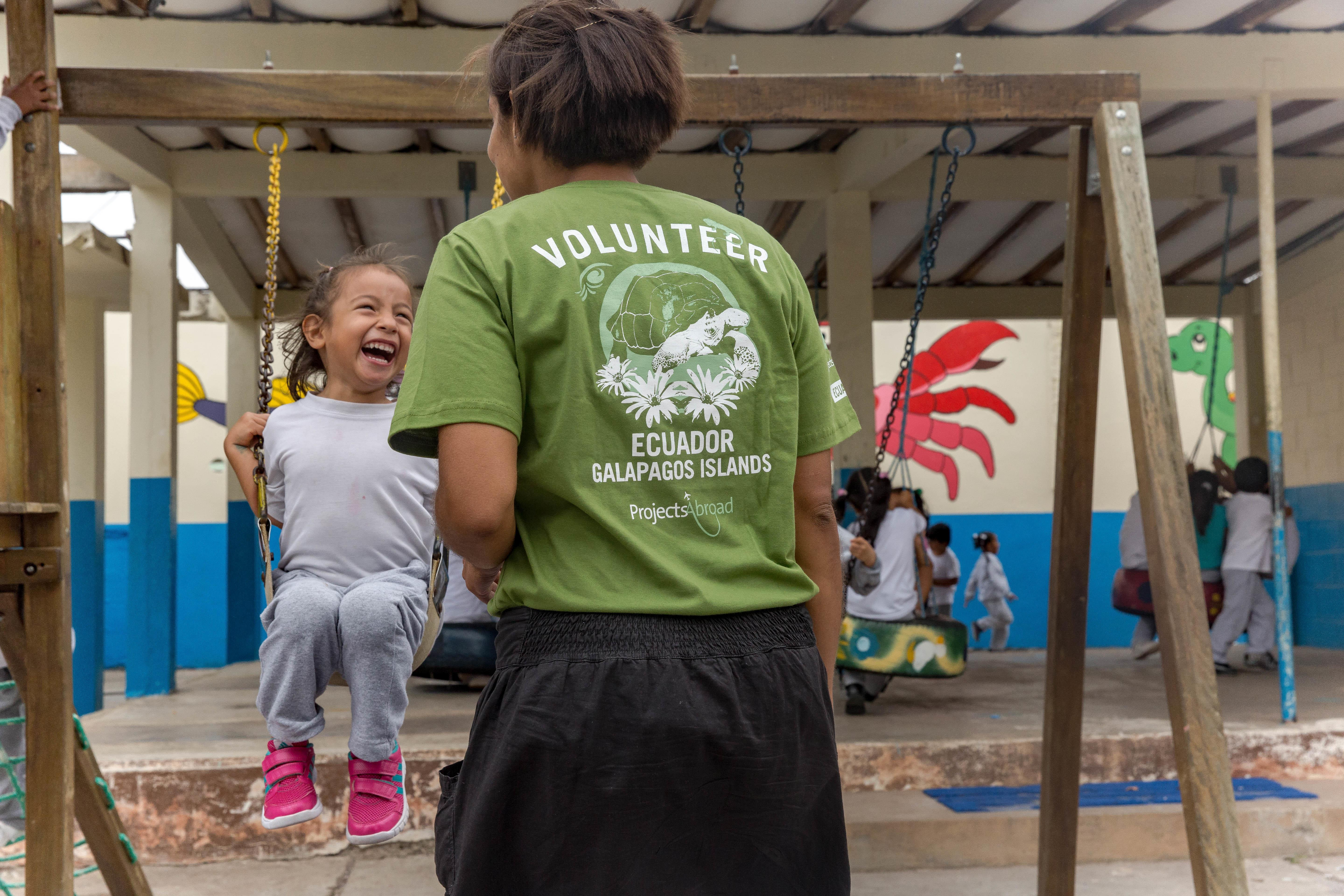 A teenager does conservation volunteer work and works with children in the Galapagos